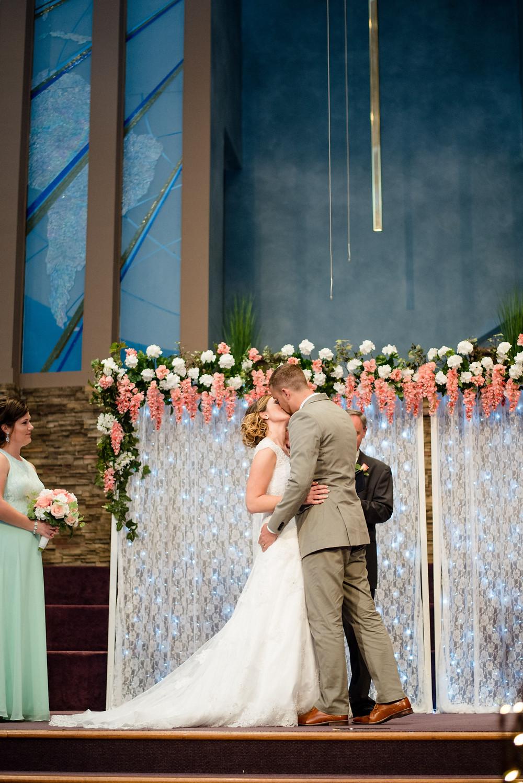 first kiss, ceremony, wedding photographer