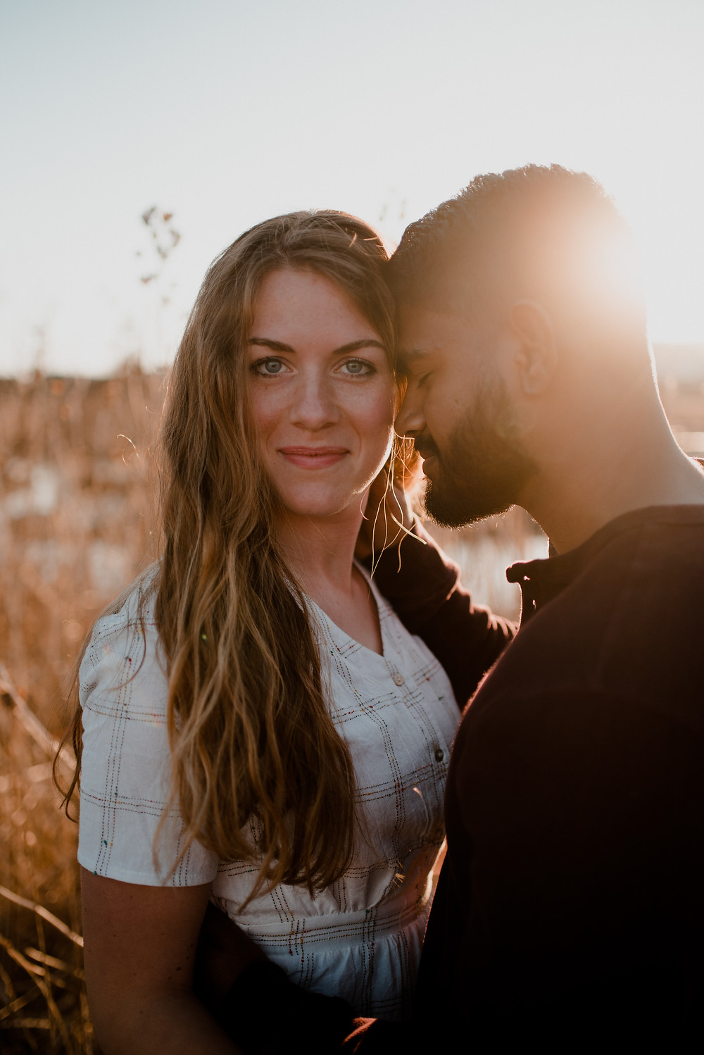 outdoors field romantic sunset engagement photo