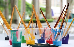 Image of a paintbrushes inside of cups