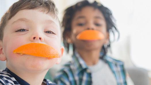 image is of Children eating orange peels
