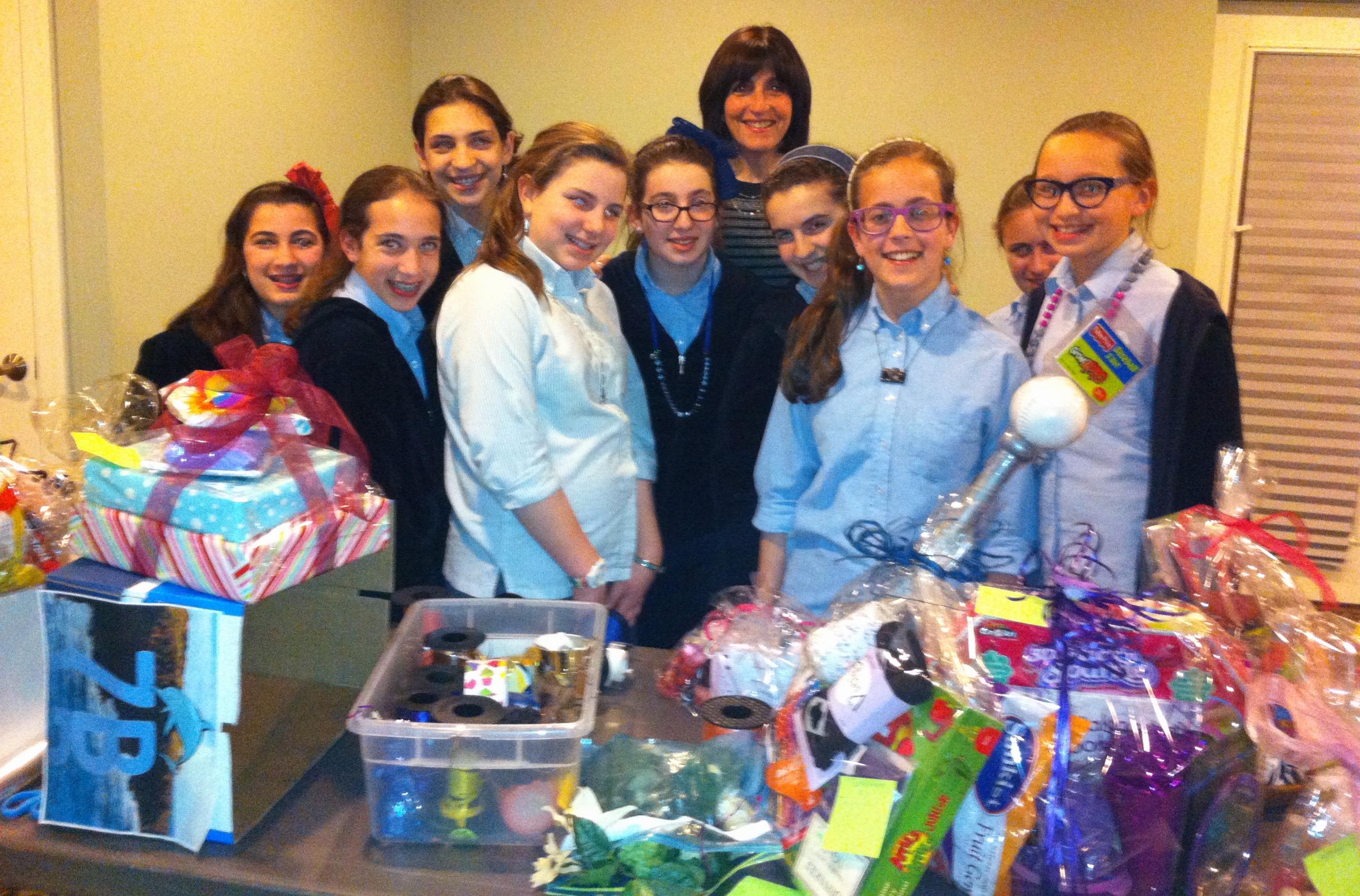Girls w wrapped toys w Leeba