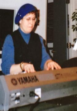 Lisa at keys in studio