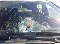 Driver saved from rock attack