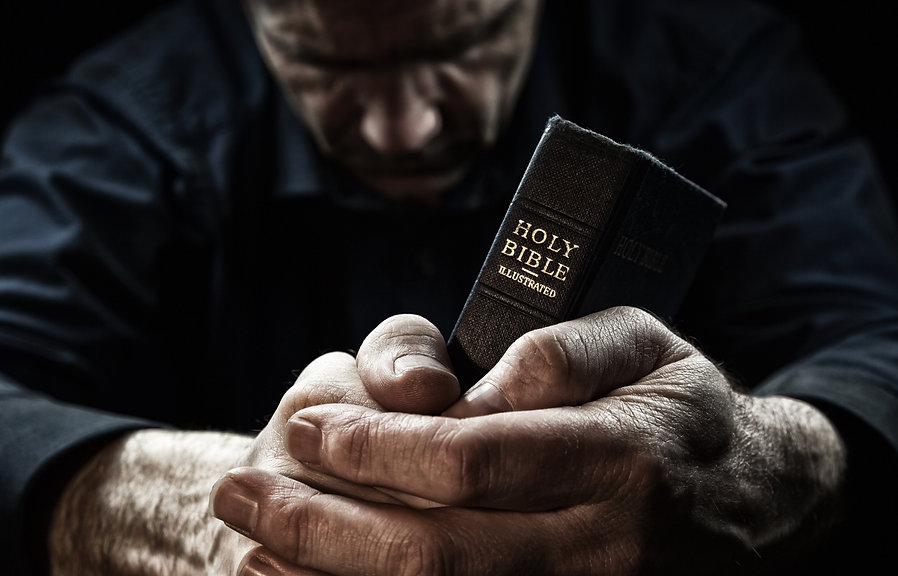 Black-man-with-bible.jpeg