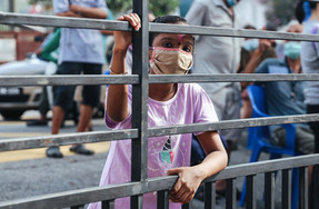 A portrait of a girl outside the public medical centre during the impact of the novel Coronavirus (Covid-19)