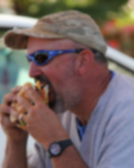 man_eating_burger_remove_blemish.jpg