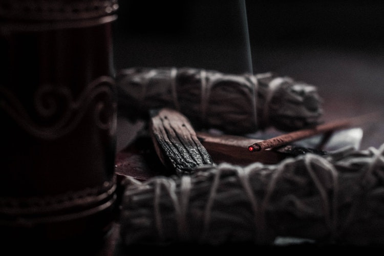 Sage Palo Santo and Incense burning