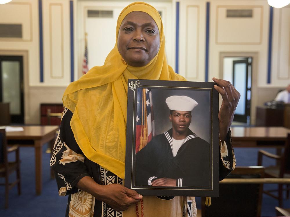 Rukiye Abdul-Mutakallim holds a photo of her son, Suliman Ahmed Abdul-Mutakallim. He's a Navy veteran and served in the Iraq War.