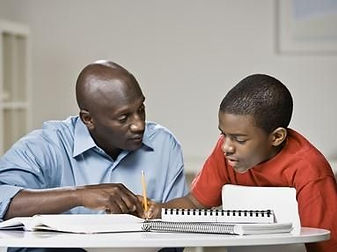 father helping son with homework .jpg