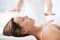 Midsection of therapist performing reiki