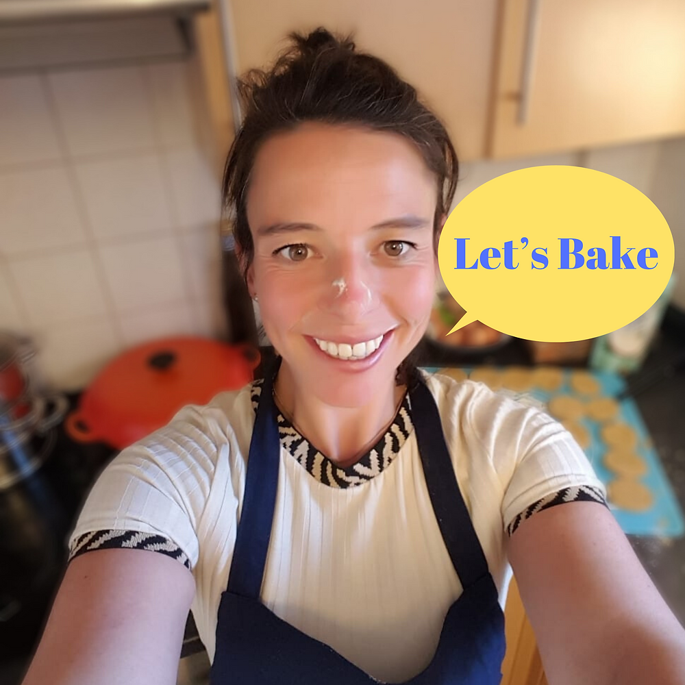 Bakeeze having fun the kitchen not worried or stressed by the mess. Flour on her nose. Baking fro stress relief