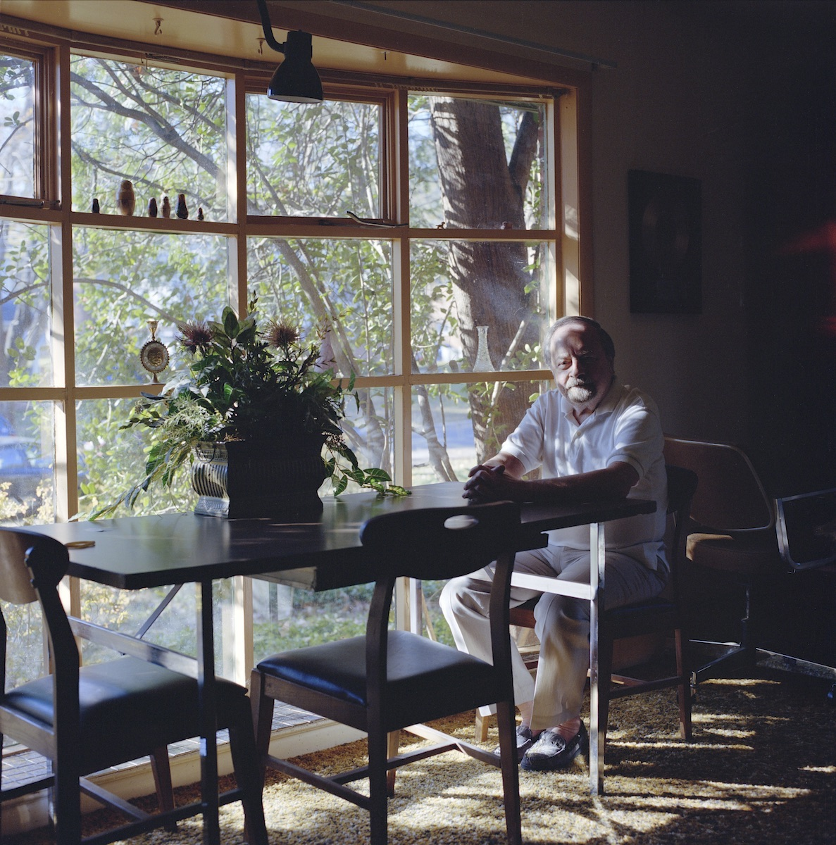 holocaust survivor sits in his home looking at camera