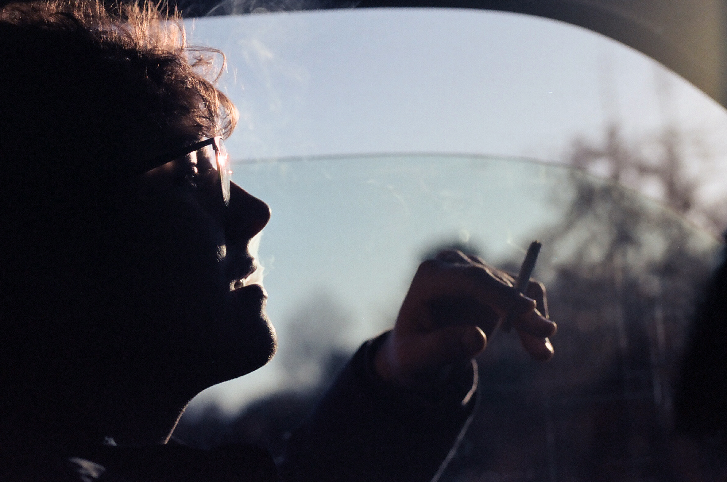 film photograph of man smoking cigarette