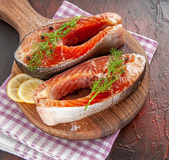 front-view-raw-fish-slices-on-dark-red-meat-color-photo-meal-food-seafood-dish-barbecue_ed