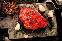 raw-meat-with-spices-on-dark-surface-ready-for-cooking_edited.jpg