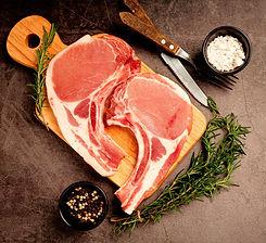 raw-pork-chop-steak-on-the-dark-surface_edited_edited.jpg