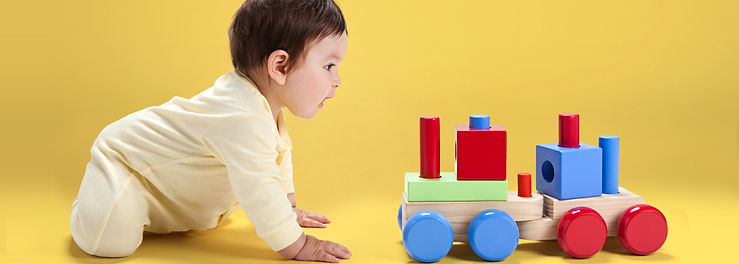 Baby with Wooden Toy_edited.jpg