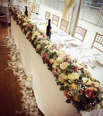 Top table wedding flowers at Thornton Manor