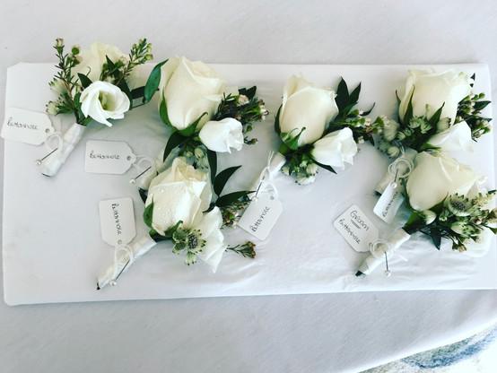 White men's wedding buttonholes