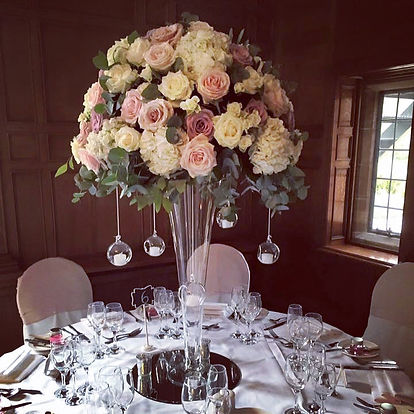 wedding decoration and table centrepieces in Cheshire. Venue Inglewood Manor. Wedding florist in Warrington, Cheshire. Covering Manchester, Liverpool, Lancashire and Chester. Wedding table centrepiece trumpet vase with blush and dusky pink flowers.