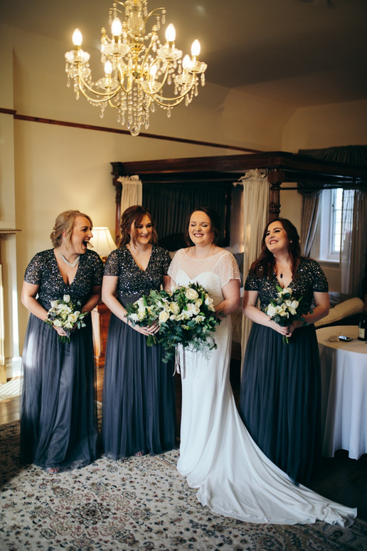 White and greenery bouquets with Navy bridesmaids at West Tower, Lancashire