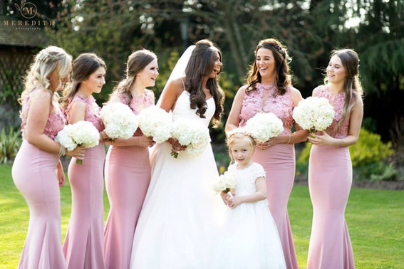 All white bride and bridesmaid bouquets