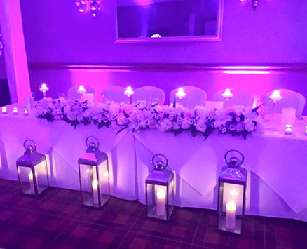 Top table flowers Carden Park Hotel