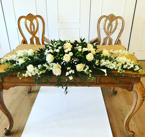 Registrar table flowers West Tower