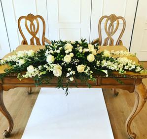 Registrar table flowers West Tower