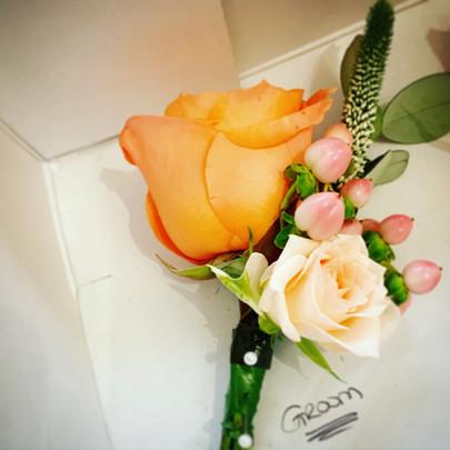 Peach wedding buttonhole