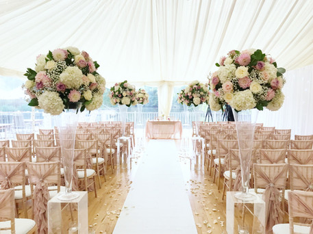 wedding ceremony and flowers at thornton manor lakeside marquee