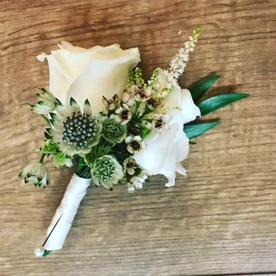 White rose buttonholes in Warrington