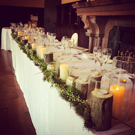 rustic top table decoration at peckforton castle