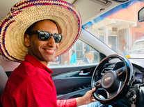 Driver Sufiane Hat facing smile classic
