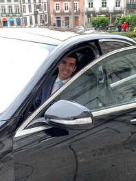 Driver Tiago peering out of car.jpg