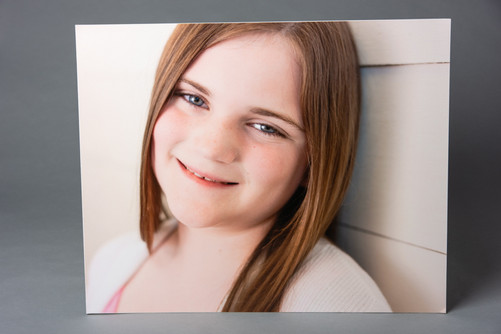 A redhead Caucasian girl smiling on the camera on a 16 x 20 inch print. Aura Lux Photography Proud to Be Me tween session in Winter Garden FL