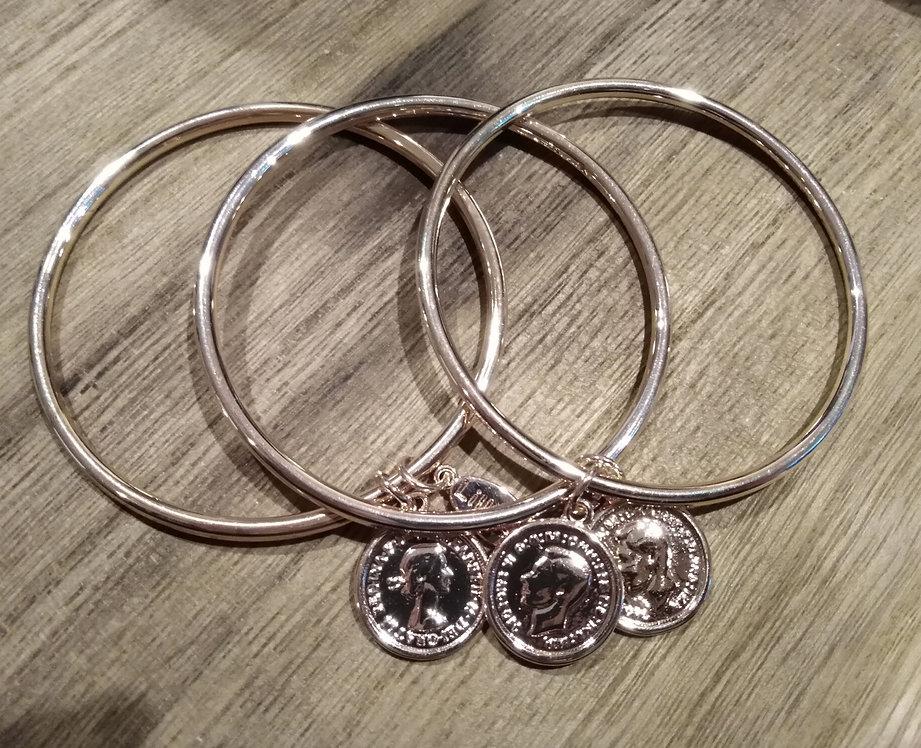 Three coin bracelets
