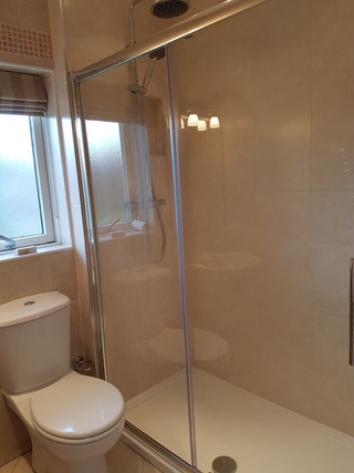Bath to shower tray conversion