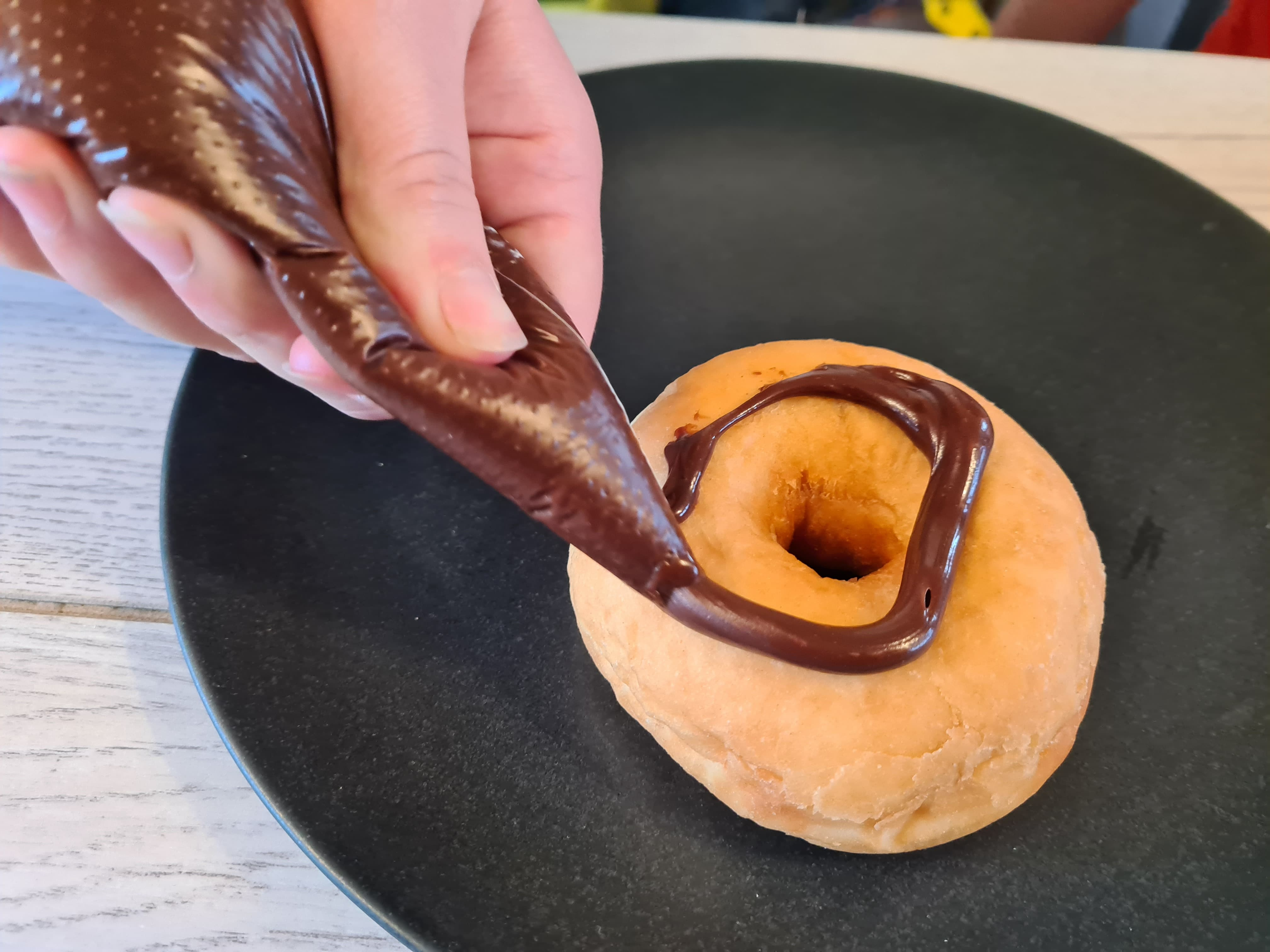 decorating a donut