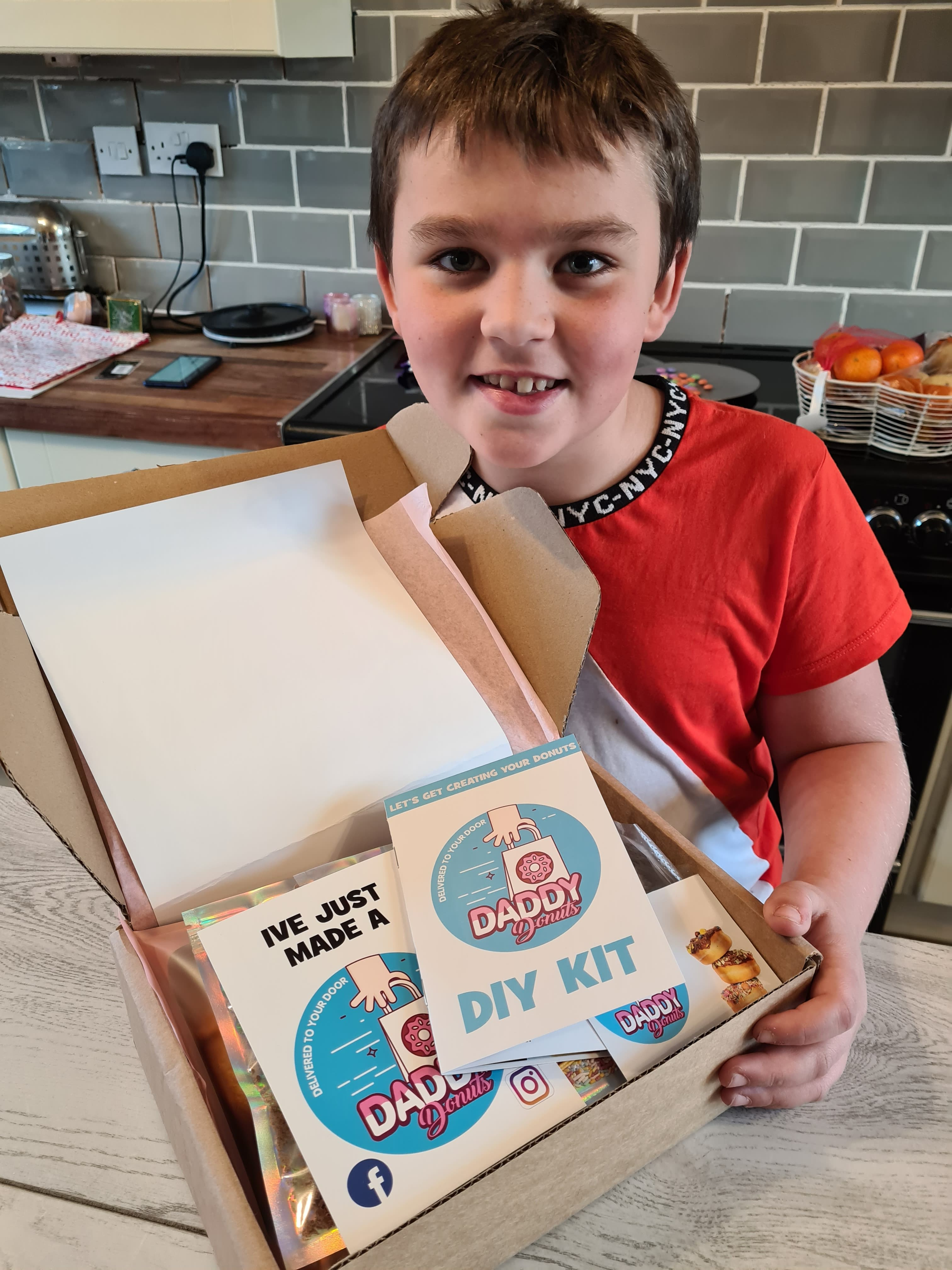 happy boy with his DIY donut kit DADDY DONUTS