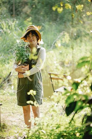 Girl holding a tomato plant.jpg