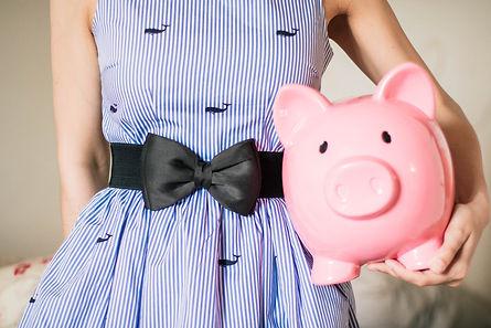 Girl holding a piggy bank.jpg