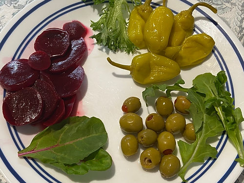 PIckled beet, olives, peppers on a plate.jpg