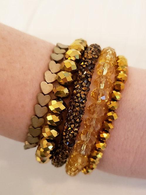 Kit de pulseiras douradas