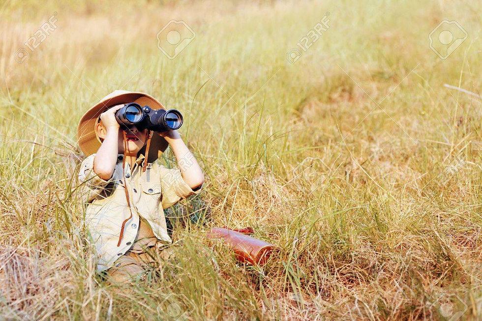 14055862-young-boy-plays-safari-explorer