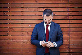 Business man looking at phone