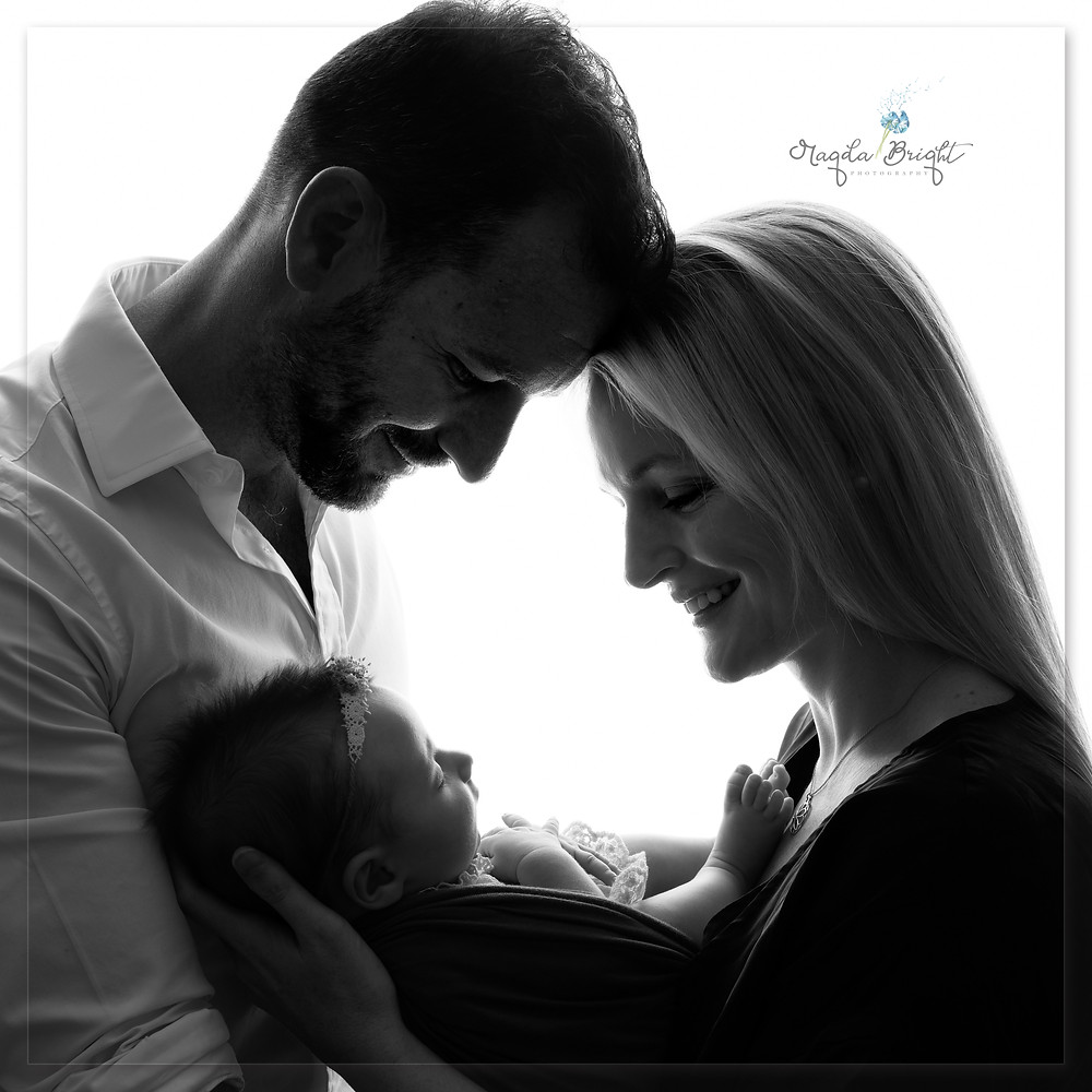 Parents and baby silhouette photo in black and white