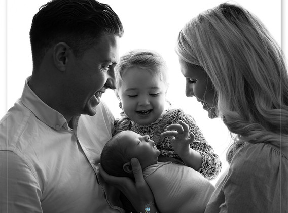 Family with a new baby photo