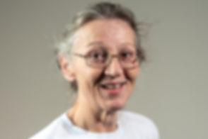 Headshot of a smiling woman. Commercial photographer. Commercial photography. Headshot photographer. Headshot photography. Cambridge. London. United Kingdom. East Anglia. Staff headshots. Employee headshots.
