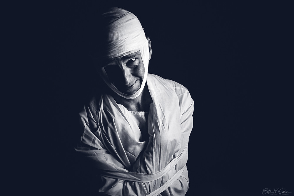 An image of a man in a straight jacket and head wrapped in bandages. Mental health awareness. Commercial photographer. Commercial photography. Travel photographer. Travel photography. Wedding photographer. Family photographer. Cambridge. Haverhill. Elton Cilliers. EmC Photography.